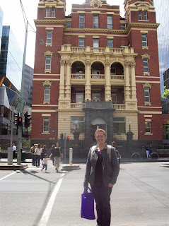 Amber standing in front of the Queen Victoria Women's Center, the last remaining building of a women's hospital
