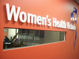Red wall with lettering for Women's Health Victoria