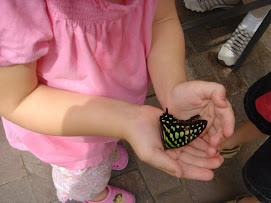 Abby holding butterfly