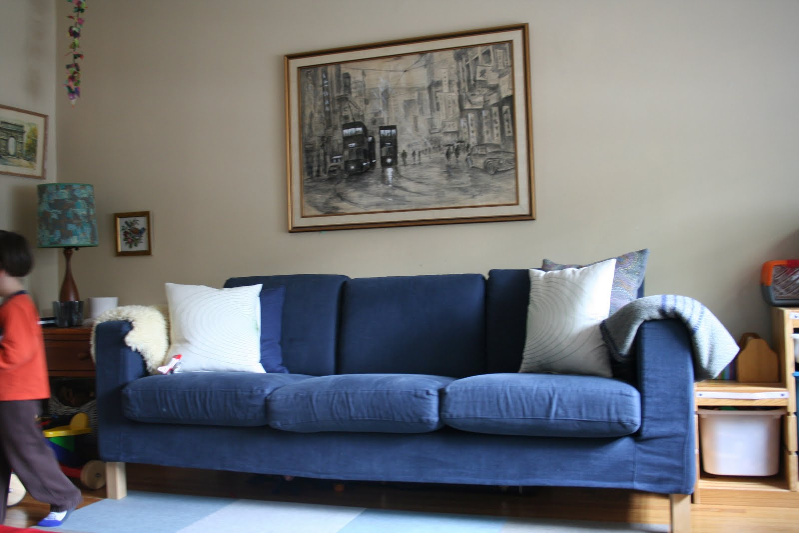 It's your typical Ikea navy blue sofa and it needs sprucing up. title=