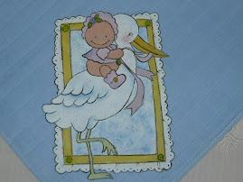 fralda azul com cegonha