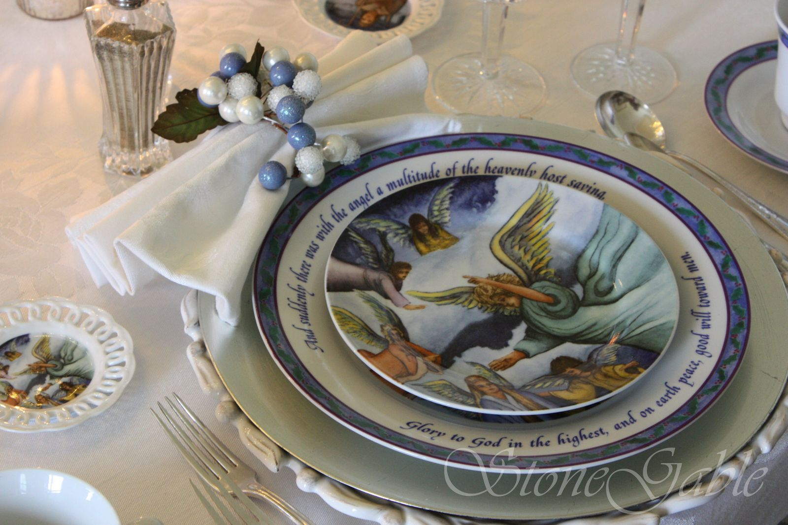 Vintage damask napkins are folded to resemble bows. They are gathered up in a napkin ring made out of a floral pick. The pick is bent into a circle. & Bethlehem Christmas Tablescape - StoneGable
