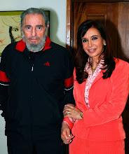 Cristina junto al inmortal Fidel.