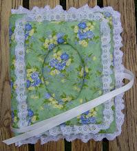Minnesalbum med somriga blommor