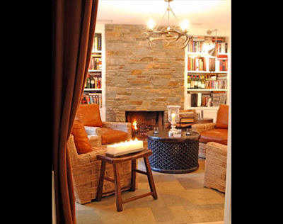 Stone Clad Fireplace Surround And Antler Chandelier Reads Masculine