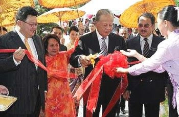 Colourful ceremony: Mohd Khalil (centre) cutting the ribbon to signal the reopening of the hotel. Looking on are Chief Minister Datuk Seri Mohd Ali Rustam (second from right) and Datuk Mark Yeoh.