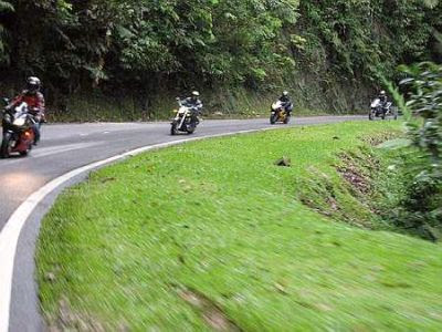 Scenic sight: The riders taking a corner during their outing.