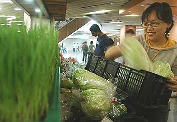 Simple steps: Tai filling her grocery basket with organic greens at the new Justlife outlet.