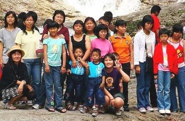 Happy together: The mothers with their children posing for a group photo.