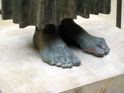 The feet of the driver