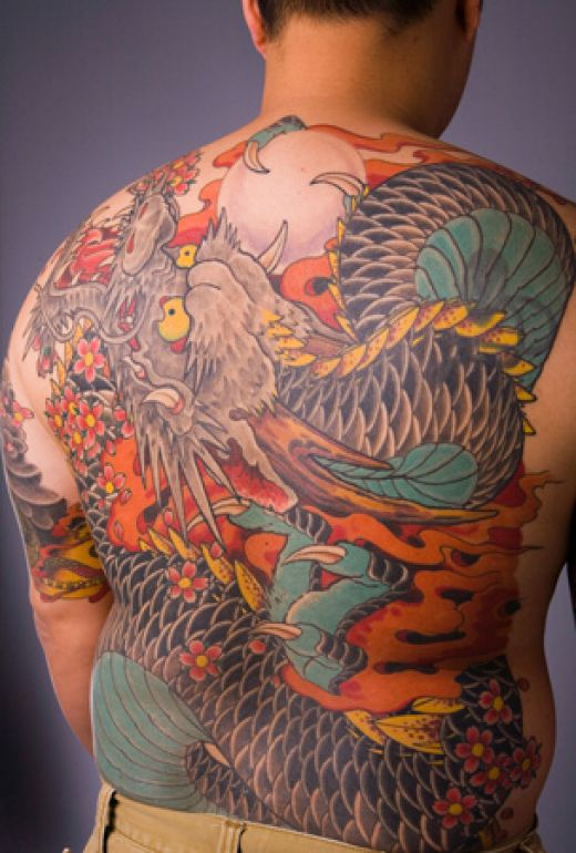 color and black half sleeve dragon tattoo
