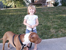 We take Jason's Dog Disel, for a walk everyday! Cora likes to hold the leash by herself.