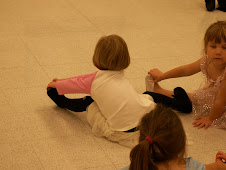 Cora at her dance class~doing stretches!