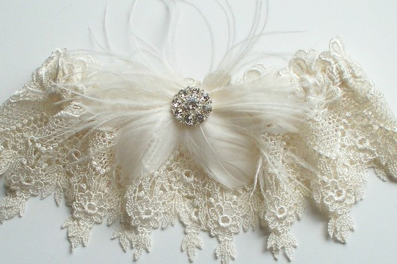 The feathers and rhinestone make it sexy while the lace gives this bridal