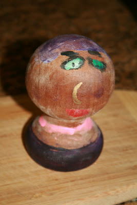 Painted fence knob lady