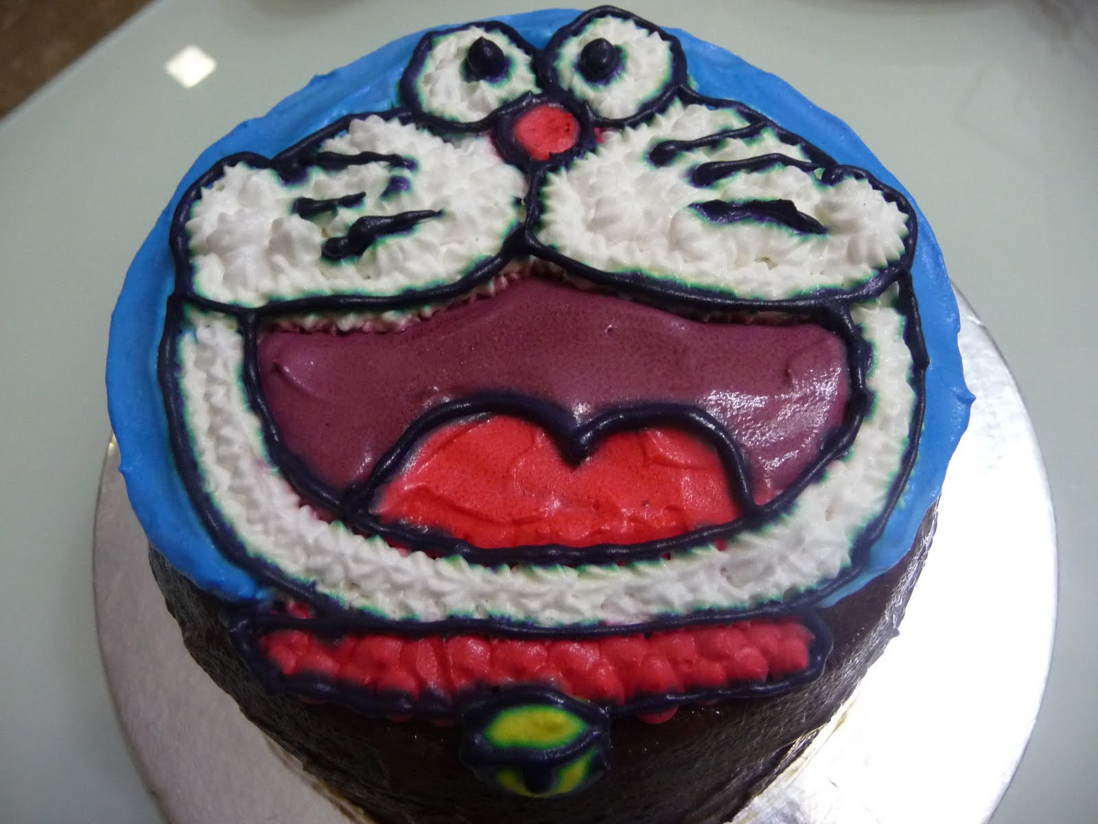 ... birthday song with a symbolic candle pluck onto the nose of Doraemon