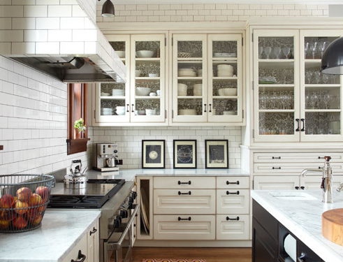 Tile in this space adds a bit of vintage charm to the kitchens