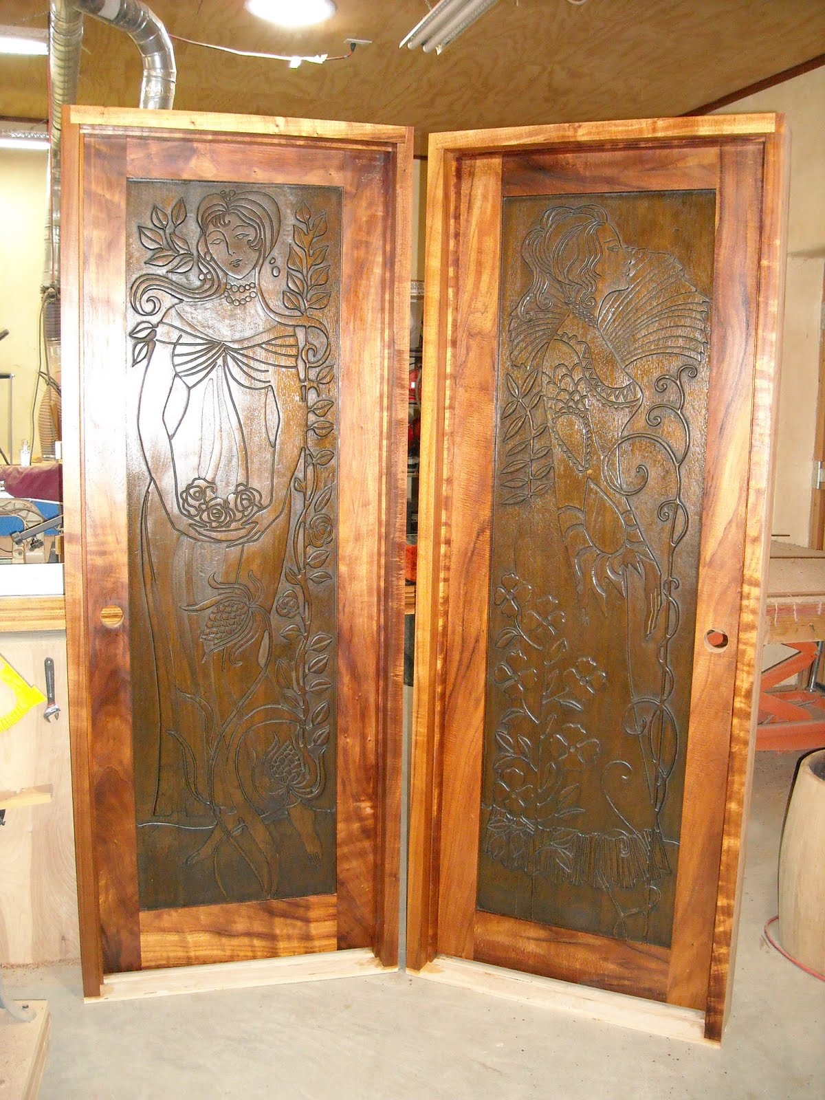 The panels for these doors were recycled/restored. Mahogany panels with mesquite frames and jambs. $1200 + materials. & Ironwood Hill Design