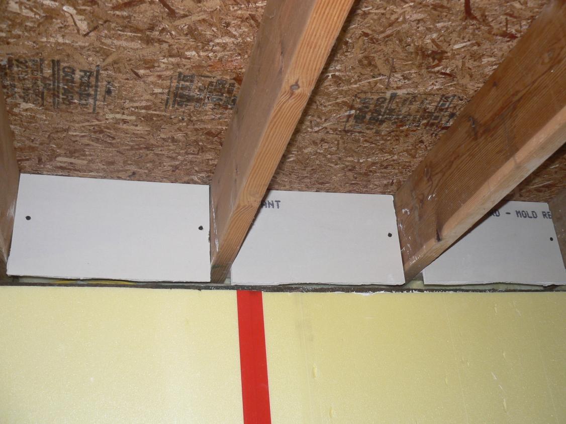 Epic basement remodel january 2011 for Floor joist insulation