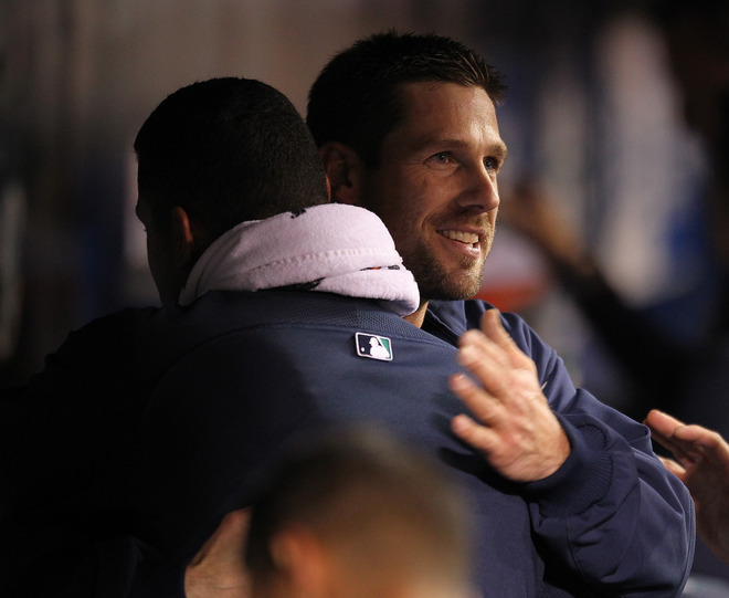 cliff lee family. Cliff Lee receives a congratulatory hug from teammate Felix Hernandez after