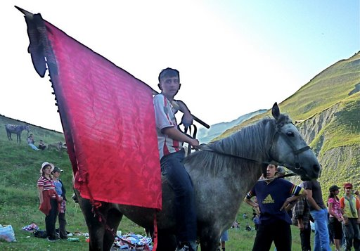 [Boy+with+flag+on+horse]