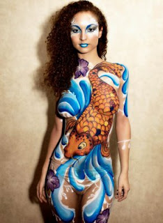 koi fish body paint the front of  the female body