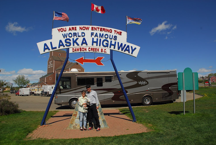 "We Are Standing in Front of the Mile ""0"" Sign Near the Visitor's Center in Dawson Creek, BC"