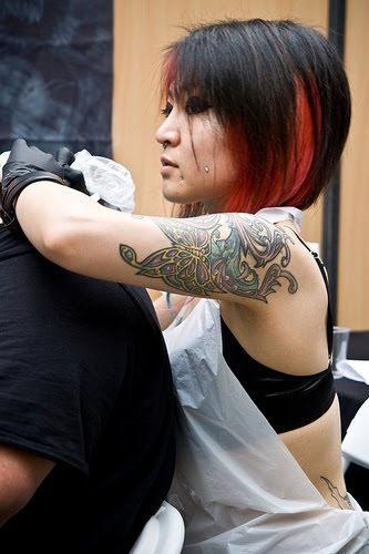 Dark colored tattoos are nice to look at on the shoulder especially