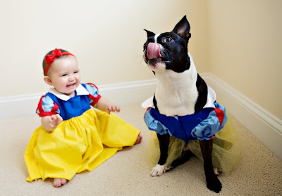 baby laughing with dog