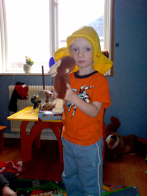mannen med den gula hatten