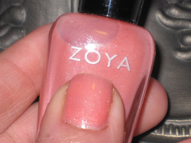 Zoya Cassi  almost a little milky opaque peachy- pink coral hue with a    Zoya Austine