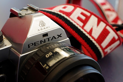 Pentax MX with red pentax strap