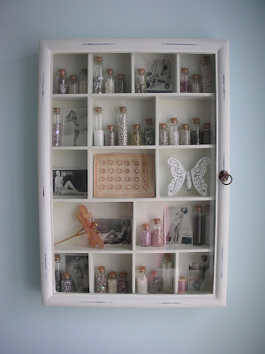 Curio cabinet in the craft room
