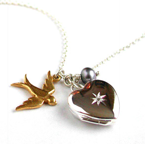 Diamond set heart locket with swallow by Alex Monroe
