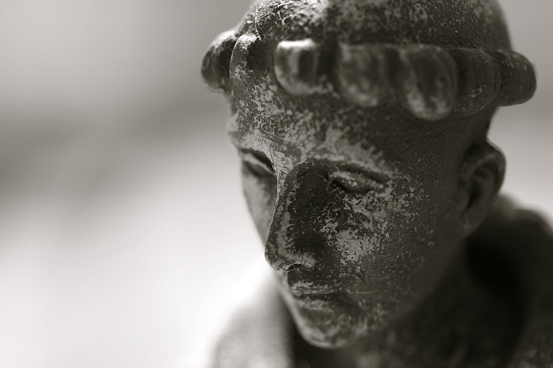 monk statue black and white photo