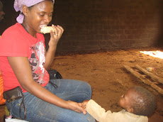 Eating with One of Our Villages Youngest Neighbors A Pygmy Baby