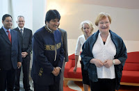 Finnish President Tarja Halonen (R) welcomes Bolivian President Evo Morales at the presidential residence in Helsinki May 21, 2010.