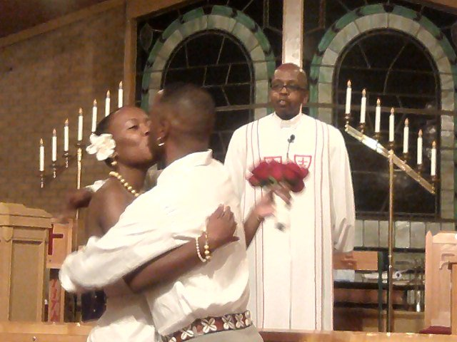 small wedding ceremony at Newman AME Church in Pontiac MI at 700pm