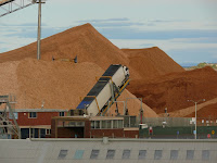 Woodchips on Burnie Wharf, with truck tipper - 8 Mar 2007