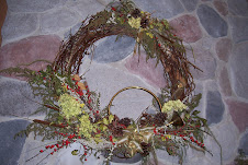 A Christmas wreath made with natures flowers of Winter Berrries and Sweet Annie.