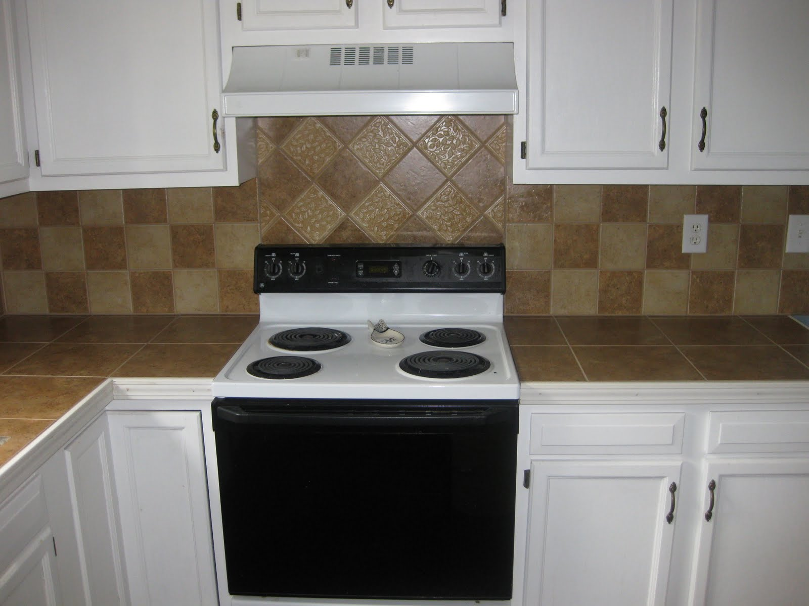 Countertop Backsplash Trim : ... kitchen. A wood trim is used on the edges of the Countertop for a