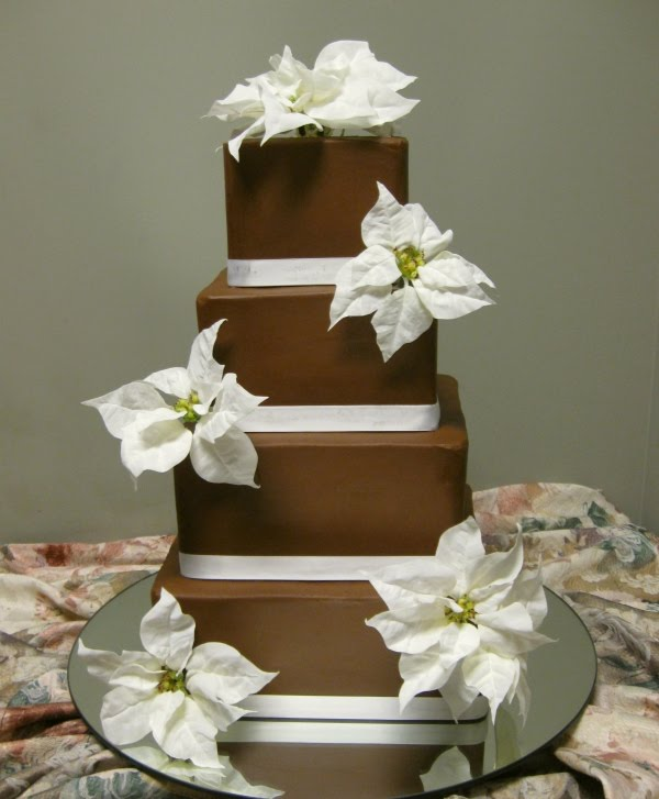 This wedding cake is decorated with sugar snow flakes and beautiful red