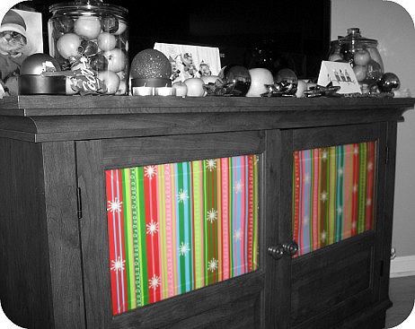decorating with wrapping paper for christmas in glass cabinets