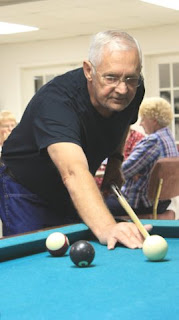 Photo of Palmer playing pool