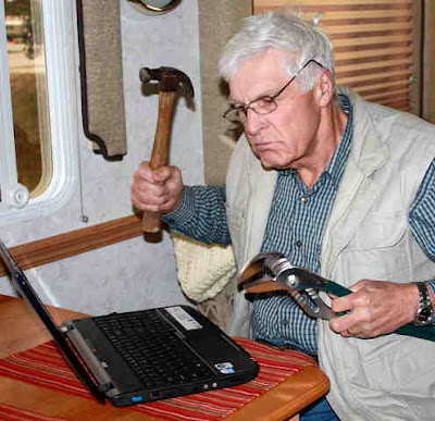 Photo of Keith trying to solve a computer problem.