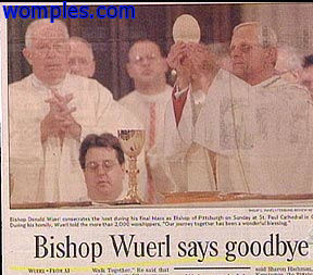 really funny newspaper photo of floating bishop head in church