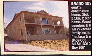 funny real estate phot of house on slope that is quality construction