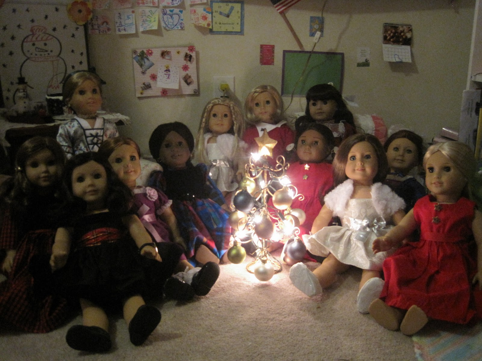 this is a picture of all of our american girl dolls by their tree - Christmas Decorations For American Girl Dolls