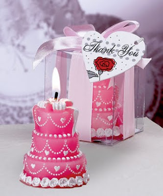 pink wedding cake candles with ribbon