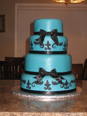 Teal Wedding Cakes With Ribbon Lilies White Rose Flowers and Acecories